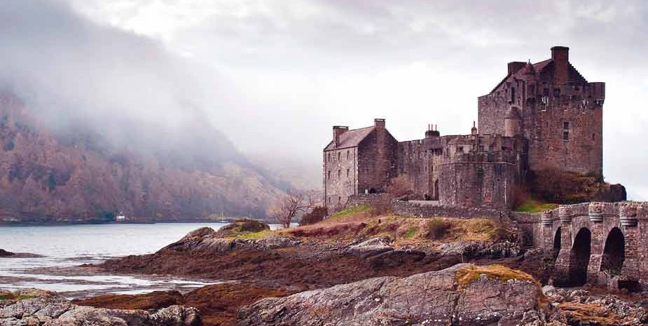 Eilean Donan castle with the Isle of Skye in the background